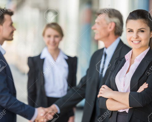 41673859-Meeting-of-business-people-Two-confident-business-men-shaking-hands--Stock-Photo